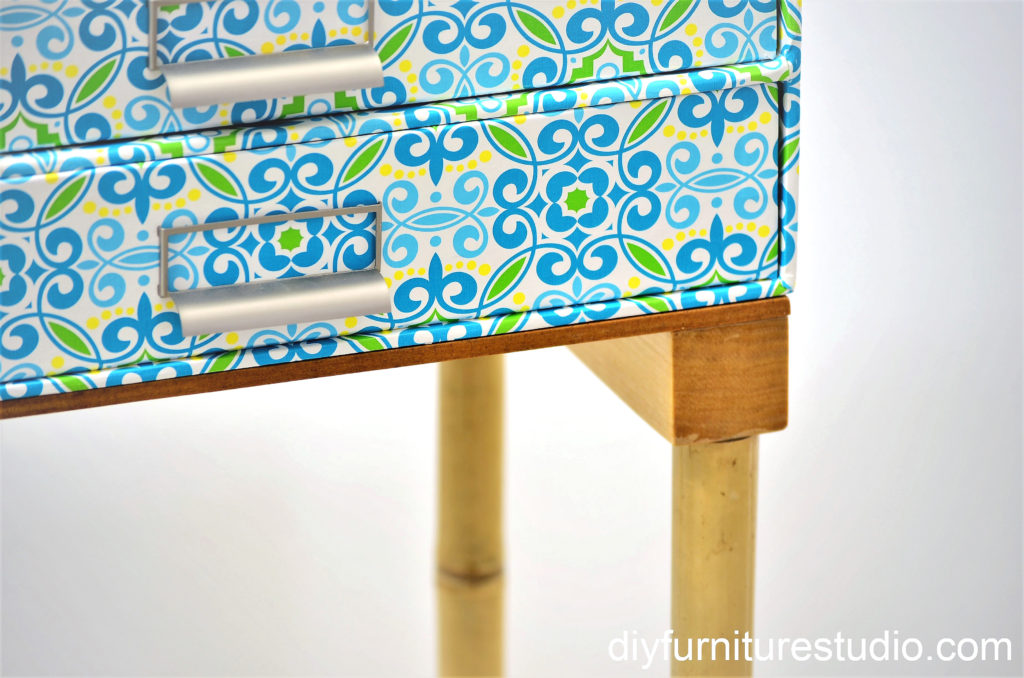 DIY nightstand with bamboo legs made of upcycled garden stakes.