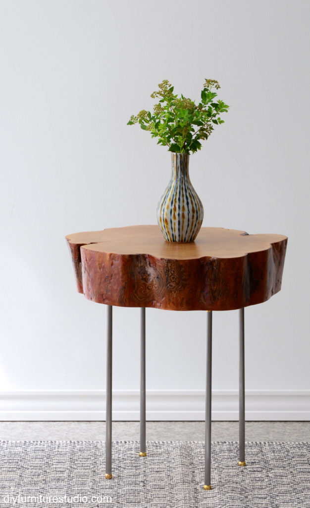 DIY Live edge tree slice side table with standalone legs made of lamp pipe, brass flanges, and brass ball feet