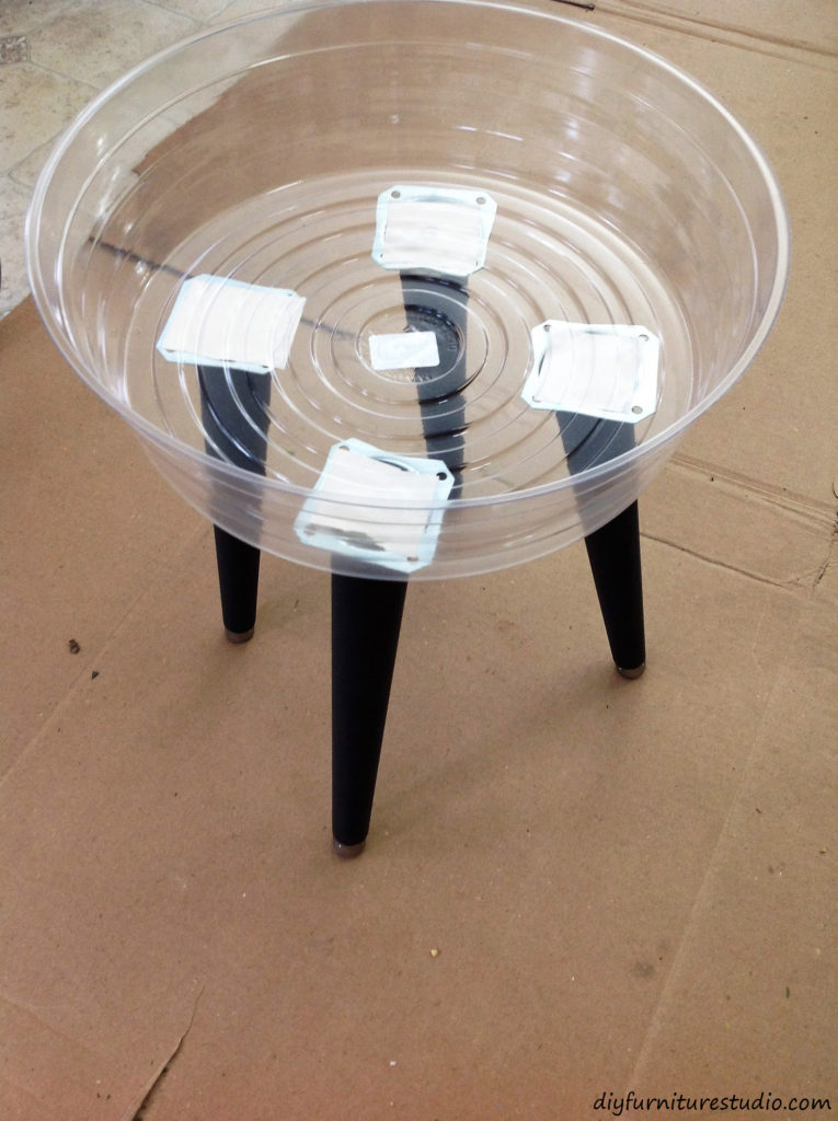 DIY cement side table. Trial run with double-sided tape to determine location for top plates.