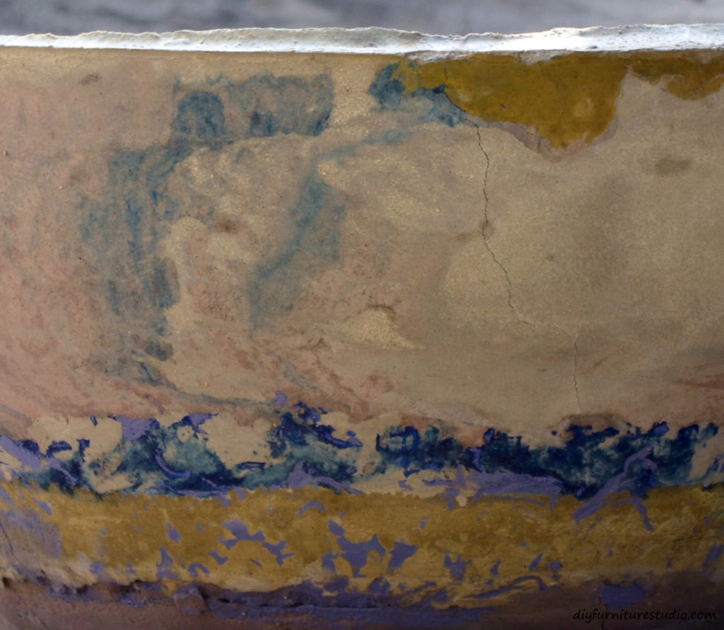 Close-up of DIY cement bowl tinted with latex paint.